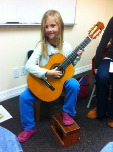 Maeve at her first lesson with her new guitar.